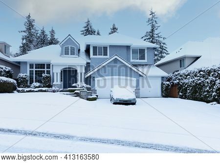 Curbside View Of Home After Recent Snowfall In Pacific Northwest Of United States