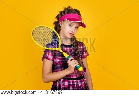 Full Of Energy. Happy Childhood. Kid In Cap Hold Racket. Child With Racquet. Teen Girl Do Sport Trai