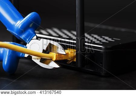 Cutting And Disconnecting The Network Internet Connection With Cutting Pliers.