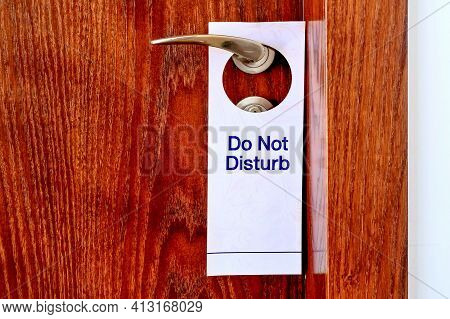 Do Not Disturb Sign Hang On Door Knob. Do No Disturb Sign At Hotel Room Door. Close-up