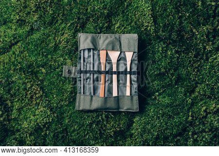 Set Of Wooden Cutlery, Straw On Green Moss Background. Sustainable Lifestyle. Zero Waste, Plastic Fr