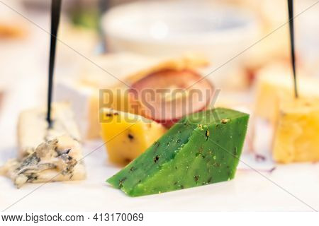 Cheese Platter On A Plate Of Pesto Dorblu.