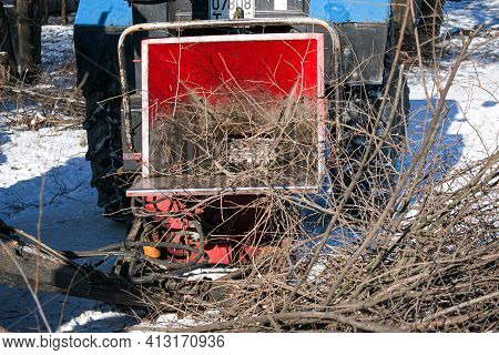 Dnepropetrovsk, Ukraine - 02.16.2021: Mobile Shredder Of Dry Branches And Trees In A City Park. Clea