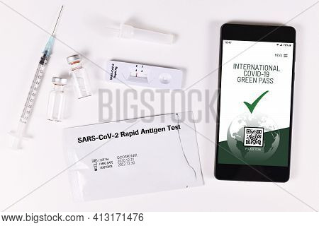 Concept For International Corona Virus Green Passport On Mobile Phone Device To Allow Privileges To