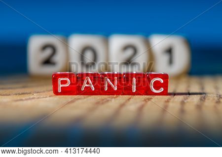Panic Is Assembled From Letters On Red Plastic Cubes At The Back Out Of Focus 2021. Concept 2021 Tim