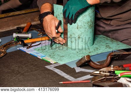 A Tinsmith In His Workshop Marks The Required Size On A Workpiece With A Felt-tip Pen And A Ruler, S