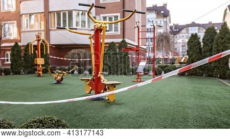 Empty Sport Ground And Playground Wrapped With Striped Barricade Tape, Stay At Home