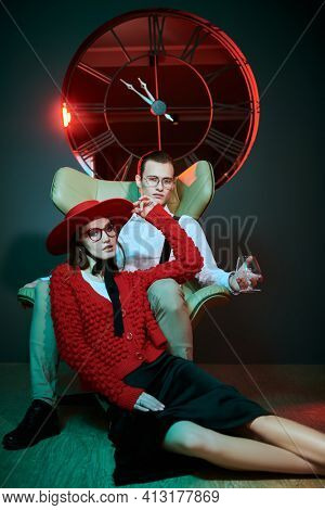Handsome young man and woman pose in a luxury apartment. Glamorous lifestyle. Fashion shot.
