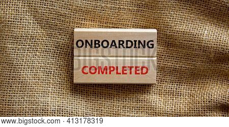 Onboarding Completed Symbol. Wooden Blocks With Words 'onboarding Completed'. Beautiful Canvas Backg