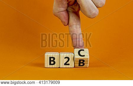 Business To Business Or Busness To Consumer. Businessman Turns A Cube And Changes Words 'b2c' To 'b2