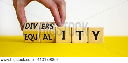 Diversity And Equality Symbol. Businessman Turns Wooden Cubes, Changes The Word 'equality' To 'diver