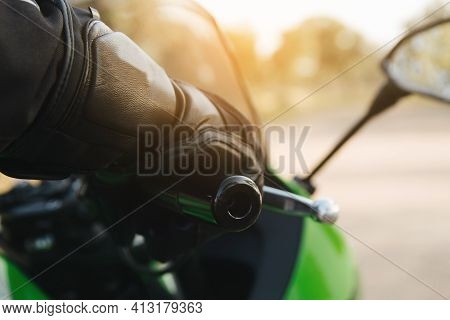 Rider With Your Hand On The Throttle Or Brake On The Handlebar Of Your Motorcycle And Your Protectiv