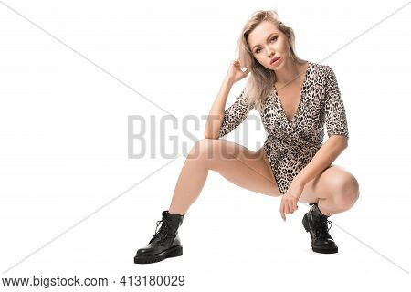 Trendy Model In Bodysuit And Leather Boots