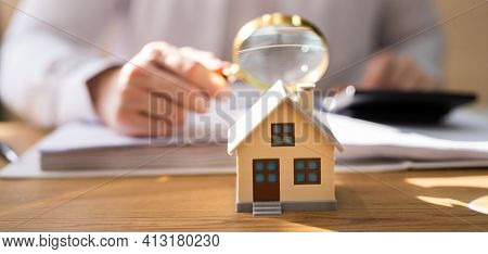 House Inspection With Magnifying Glass. Investigate Real Estate Rent