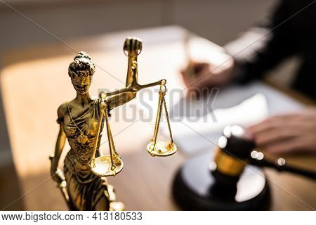 Judge With Gavel In Court Writing Legal Law Order
