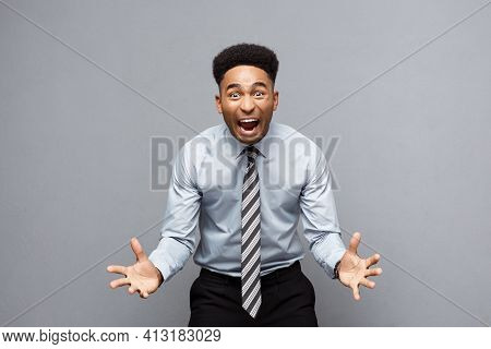Business Concept - Confident Cheerful Young African American Showing Hands In Front Of Him With Disa