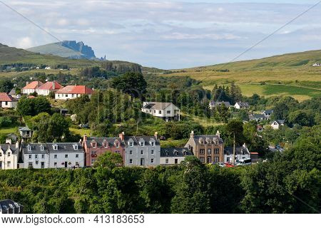 The Cityscape Of Portree Town, Isle Of Skye, Scotland At Early Sunset With Typical British Country H