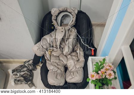 Winter Overalls For Children. Overalls For A Child From Warm Cloth. The Overall With A Hood Hangs On