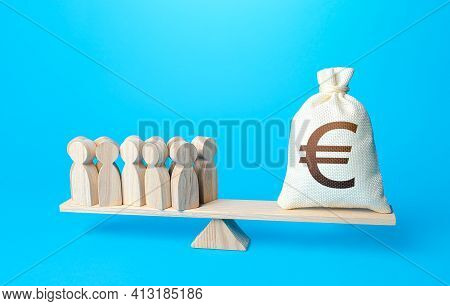 Group Of People And Euro Money Bag On Weight Scales. Required Payment Of Staff Salaries. Staff Maint