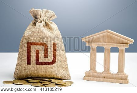 Israeli Shekel Money Bag And Bank / Government Building. Budgeting, National Financial System. Suppo