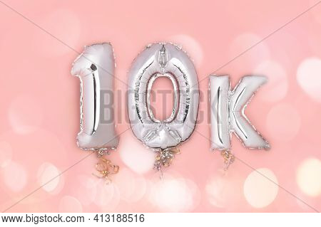 Silver Number Balloons 10k, Meaning Ten Thousand, On Pink Background. Holiday Party Decoration, 10k