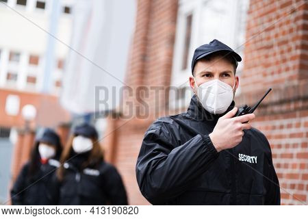 Security Officer Staff Or Bodyguard Protection In Face Mask