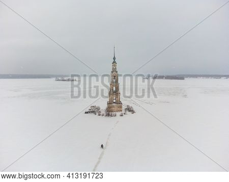 Bell Tower In The Middle Of A Frozen Lake, Top View