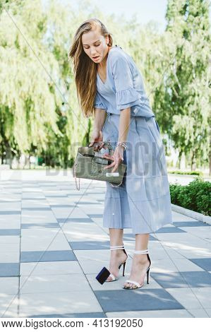 Purse Handbag, Bag Organizer, Keep Stuff Organized. Young Woman In Blue Dress Looking For Stuff In H