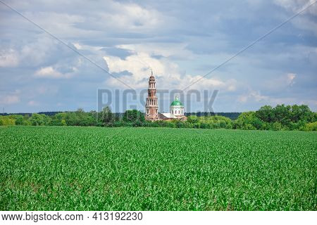 Restored Temple With A Bell Tower View From The Field