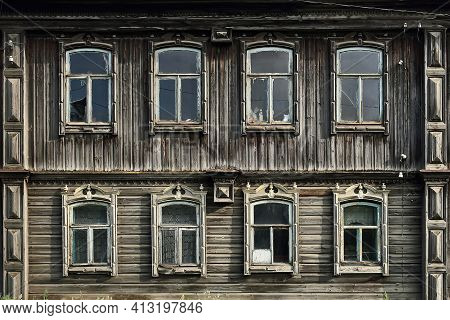 Old Russian Traditional Wooden House With The Carved Windows. Rundown House. Village Of Visim, Sverd