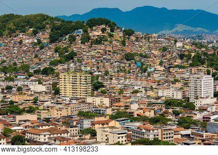 Favelas On Hills Of The Suburbs Of Rio De Janeiro City, Brazil