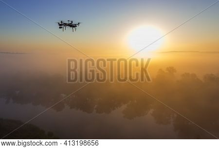 Hexacopter Drone Over Foggy Sunrise On River