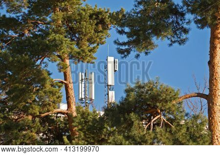 View Through Some Trees On A 4g And 5g Telecommunication Tower Antenna And Mobile Communication Syst