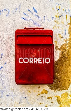 Lisbon, Portugal- May 25, 2018:colorful Metallic Mail Box In Red Color On Wall With Old Paint In Lis