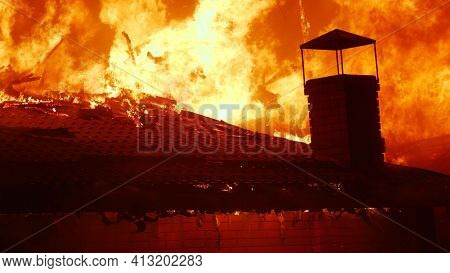 Fire Close-up. Fire On The Roof Of The House. A Burning At Building House . Home Insurance Apartment