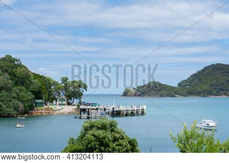 Great Barrier Island, New Zealand - February 23 2021; Wharf And Bay Of Picturesque Whangaparapara Ha