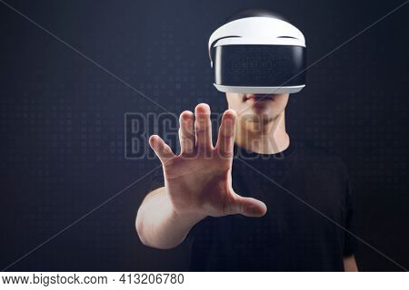 Man with VR headset touching invisible object