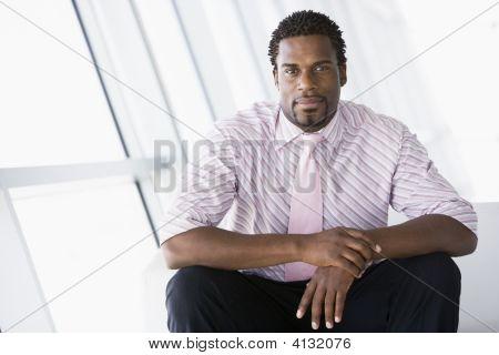 Businessman Sitting In Office Lobby