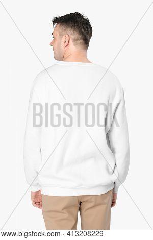 Man wearing white sweater close-up, rear view