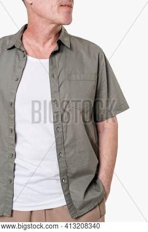 Man wearing white t-shirt underneath a gray shirt