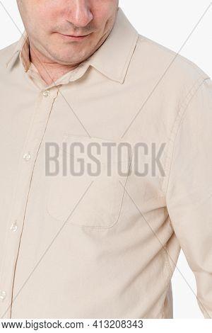 Man wearing beige long-sleeve shirt close-up