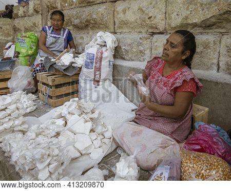 Oaxaca, Mexico - 2019-11-16 - Woman Bags Limestone To Sell To Cooks To Make Tortillas Crispy.