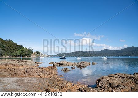 Shoal Bay Rocky Foreshore On Tryphena Harbour Great Barrier Island New Zealand.