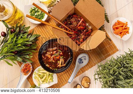 Flat Lay Of Chinese Food In Boxes, Soup And Main Course