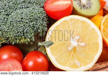 Natural Fruits And Vegetables In Wooden Rustic Box. Nutritious Food Containing Healthy Minerals And