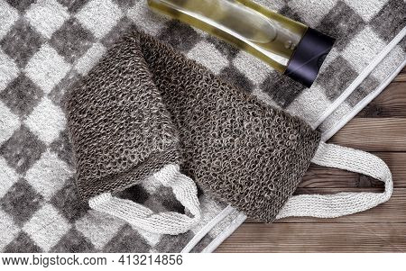 Accessories For Visiting A Bath Or Sauna On A Wooden Background: Towel, Washcloth, Shower Gel. Top V