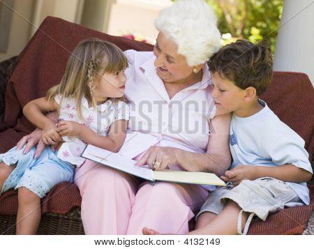 Grandmother Reading To Grandchildren.