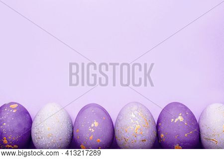 Easter Frame Of Eggs Painted In Purple Color.