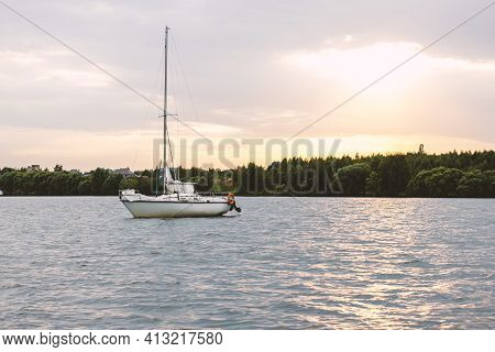 Sailboat.sailboat On The Lake. On The Sunset