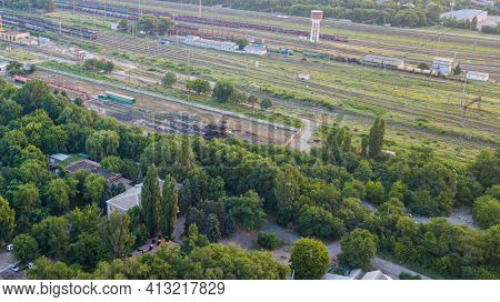 Aerial View Of Colorful Freight Trains. Railway Station. Cargo Trains. Wagons With Goods On Railroad